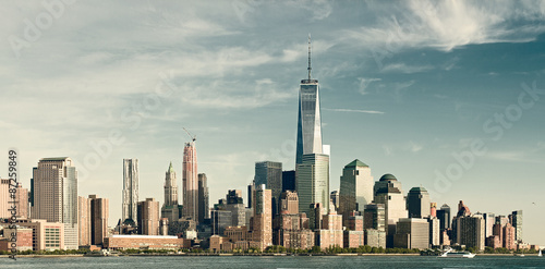 Foto op Aluminium New York New York City lower Manhattan financial wall street district buildings skyline on a beautiful summer day filtered instagraam vintage desaturated looks