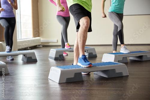 Fotografie, Tablou group of people flexing legs on step platforms