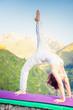 Asian woman doing yoga at mountain