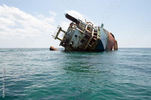 Foto op Canvas Schipbreuk Shipwreck, rusty ship wreck, sunken ship on a bright sunny day