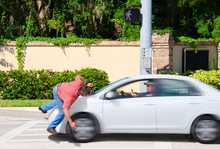 A Man That Is Texting While Driving Runs Over A Pedestrian While The Cross Now Sign Is Clearly Visible Showing That The Pedestrian Had The Right Of Way.