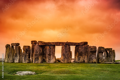 Stampa su Tela Stonehenge against fiery orange sunset sky