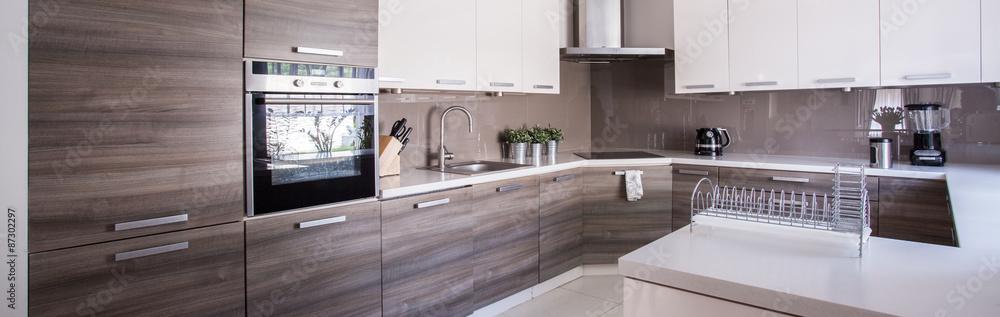 Fototapety, obrazy: Wooden cupboards in cozy kitchen