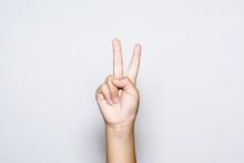 Boy Raising Two Fingers Up On Hand It Is Shows Peace Strength Fight Or Victory Symbol And Letter V In Sign Language On White Background.