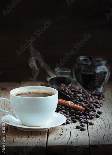 Fototapety, obrazy: hot coffee and beans on wood background
