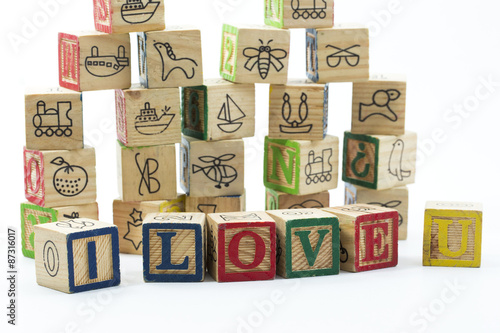 Wooden Toy Blocks Spelling I Love You Isolated On A White Backgr