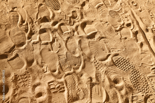 Fotografering  footwear prints on sand