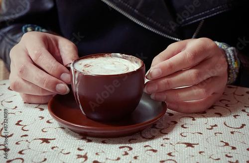 Fotografie, Obraz  Hands holding a cup of caffe mocha