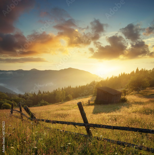 Sun beam in mountain valley in the morning time during sunrise. Natural summer landscape