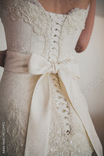 Fotografie, Obraz  Beautiful luxury lace wedding dress and white bow