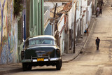 A classic car in a street in Santiago de Cuba - 87346037