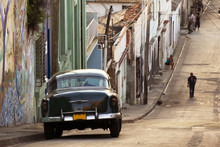 A Classic Car In A Street In Santiago De Cuba