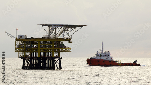 Poster Helicopter Oil rigs and a transportation vessel in the South China Sea