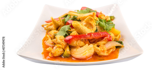 Staande foto Klaar gerecht Malaysian traditional dish of Ayam Paprik or spicy stir fry chicken on white plate over white background
