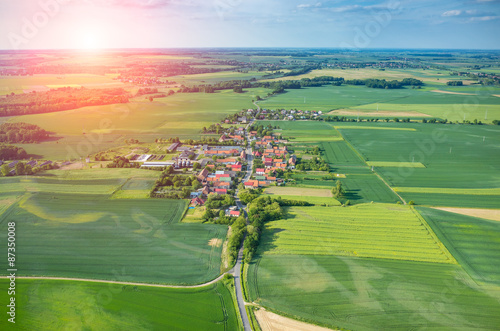 Keuken foto achterwand Luchtfoto Beautiful sunset above the small rural village