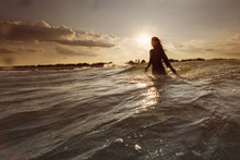 Young Woman On Sea Embracing The The World And The Waves