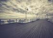 Gdynia Orlowo pier. Vintage photo of Baltic sea shore seascape.