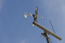 Anemometer And Wind Vane On Blue Sky