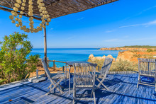 Tables With Chairs Of Restaurant On Coast Of Portugal Near Portimao Town, Algarve Region