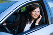 happy successful business woman talking on phone in her car