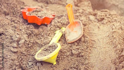 Fotografie, Obraz  Plastic children toys in sandpit or on a beach