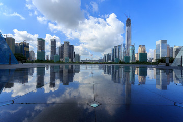 Modern skyline and buildings with empty square floor