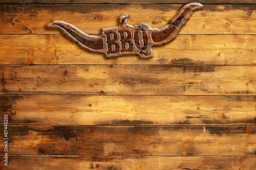 "Fotografía  plaque ""bbq"" nailed to a wooden board"