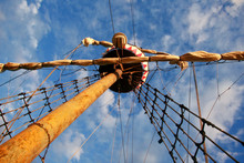 Sailing Ship's Furled Canvas Sails And Complicated Rope