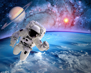 Fototapeta Kosmos Astronaut spaceman outer space planet saturn earth sun universe. Elements of this image furnished by NASA.