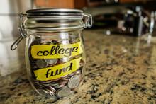College Fund Money Jar. A Clea...