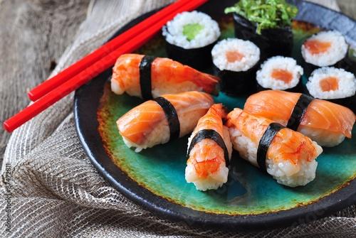 Printed kitchen splashbacks Sushi bar homemade sushi with wild salmon, shrimp, cucumber and seaweed. selective focus