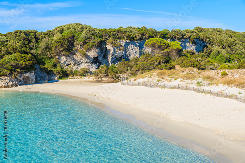 Fotografering View of sandy Petit Sperone beach with azure sea water, Corsica island, France