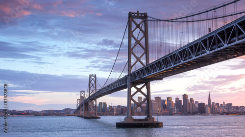 Sunset over San Francisco-Oakland Bay Bridge and San Francisco Skyline. Yerba Buena Island, San Francisco, California, USA.