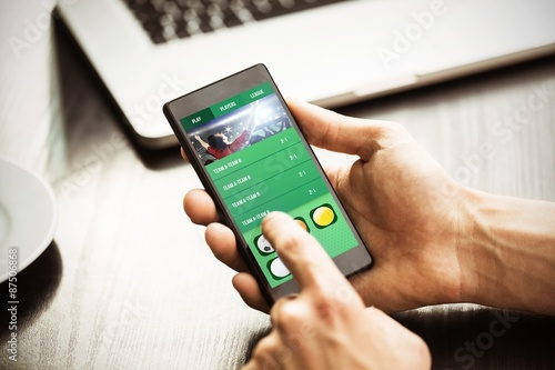 Foto Composite image of hand holding smartphone