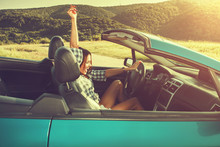 Attractive Young Woman In A Convertible