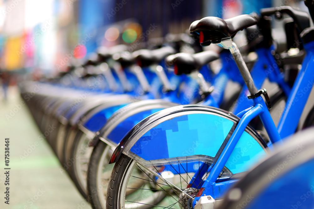 Fototapeta Row of city bikes for rent at docking stations