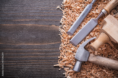 Valokuvatapetti Shaving plane claw hammer flat chisels and wooden planning chips
