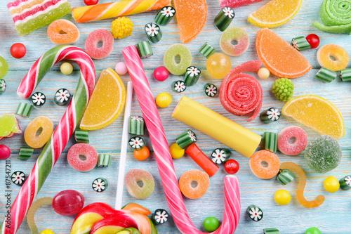 Keuken foto achterwand Snoepjes Colorful candies on wooden background