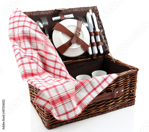 Keuken foto achterwand Picknick Wicker picnic basket with tableware and tablecloth isolated on white