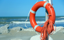 Orange Jackets With Rope To Rescue Swimmers In The Sea In Summer