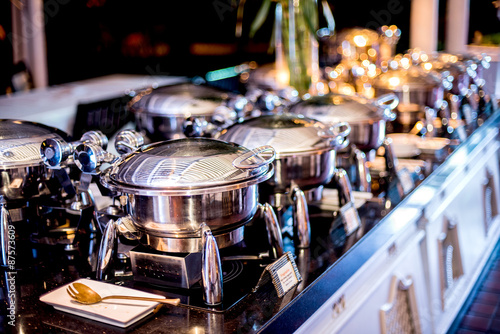 Fotografie, Obraz  Buffet Table with Row of Food Service Steam Pans