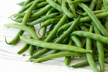 Whole French Green String Beans  On White Rustic Wood.