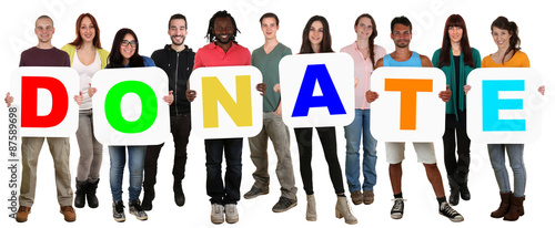 Fotografie, Obraz  Group of young multi ethnic people holding word donate money don
