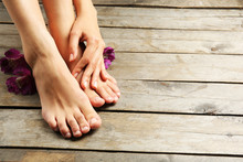 Female Feet With Flowers On Wo...
