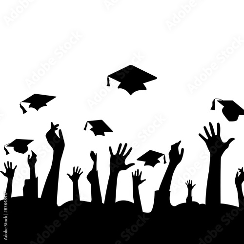 Silhouette Of Hands In The Air And Graduation Hats