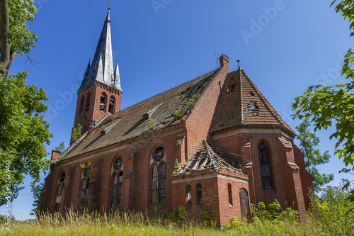Abandoned Christian church of red brick