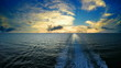 Track ship in the sea, sky and clouds at sunset, time lapse UHD 4K video