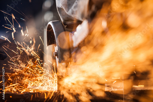 Close-up of worker cutting metal with grinder Fototapet