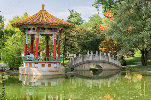 lovers sitting in chinese garden bridge - 87716670