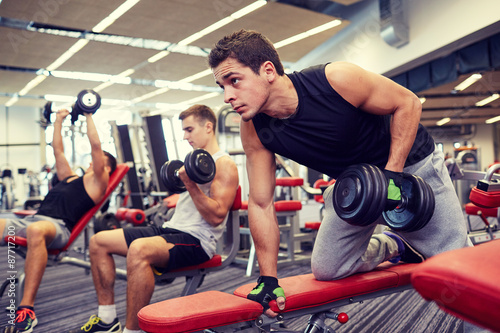 Foto op Plexiglas Fitness group of men with dumbbells in gym
